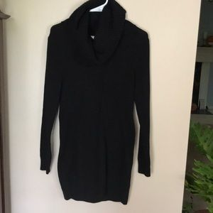 Turtle neck black form fitted dress